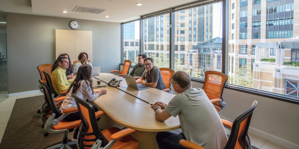Pacific Workplaces team and members using boardroom at downtown Oakland shared office space
