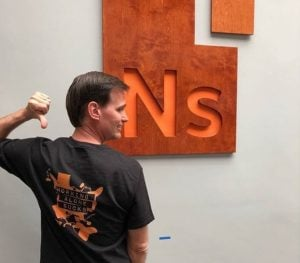 Pacific Workplaces Managing Partner Keith Warner wearing NextSpace Coworking Santa Cruz shirt